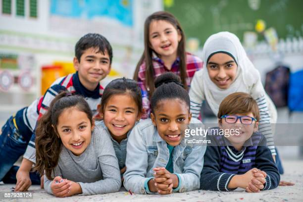 group of kids in school - muslim boy stock photos and pictures