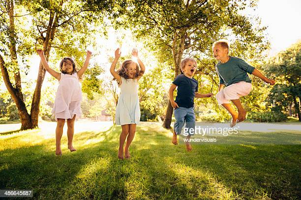 Group of kids jumping in park