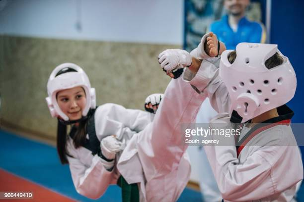 Group of kids on taekwondo training in gym