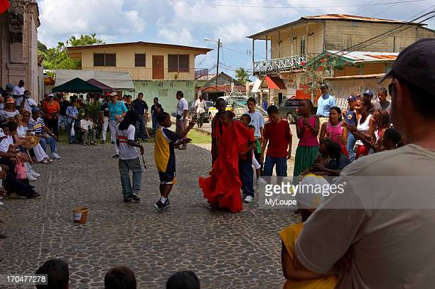 A group of kids play and dance to traditional tunes during the bi annual meeting of devils and congos in Portobello Colon Panama Central America