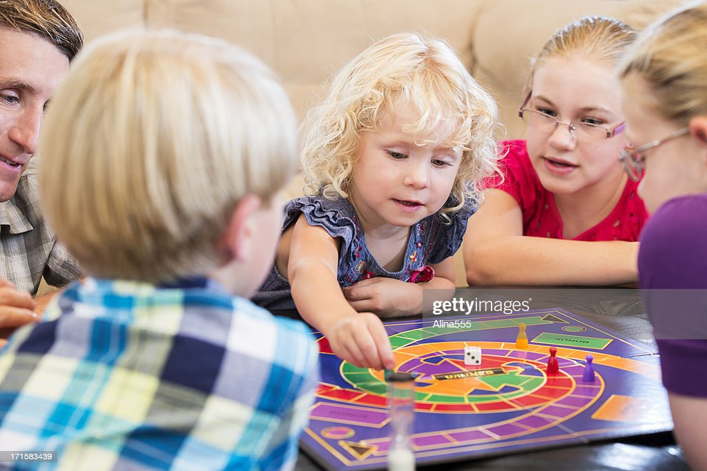 Group of kids playing a board game : Stock Photo
