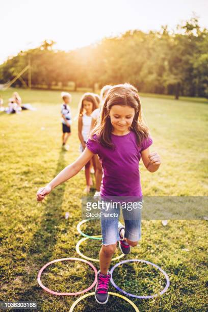group of kids playing in nature - skipping along stock pictures, royalty-free photos & images