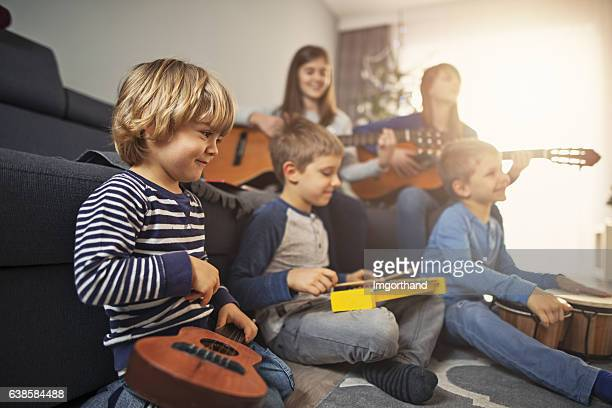 Group of kids playing music together