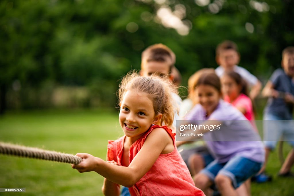Group of kids pulling a rope : Stock Photo