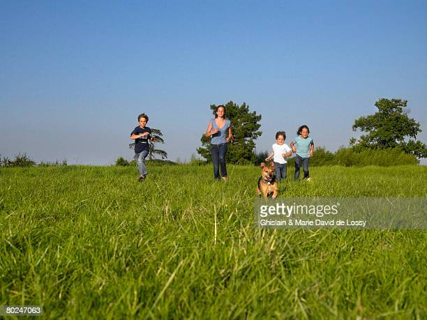 Group of kids running in a field.