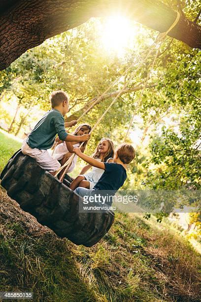 Group of kids swinging
