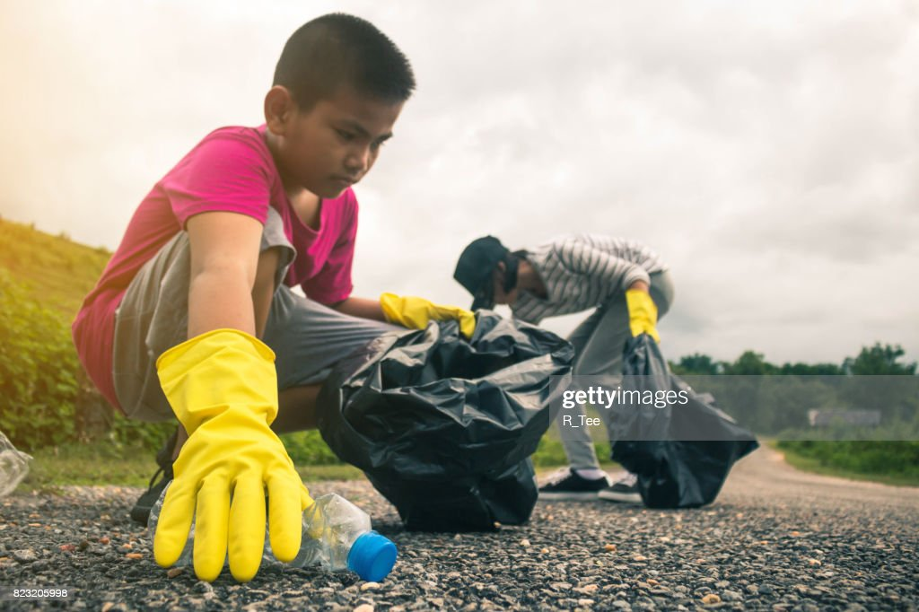 Group of kids volunteer help garbage collection charity environment. : Stock Photo