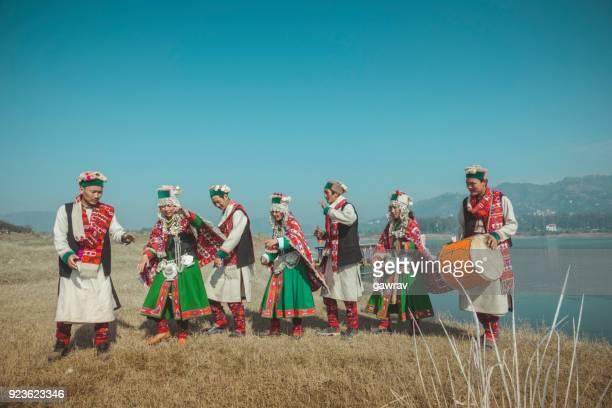 Group of Kinnaur tribal people dancing together in a group.