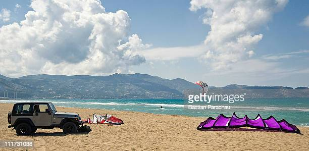 A group of kitesurfers parked their jeep on Amudara beach on April 10 2010 in Heraklion Greece