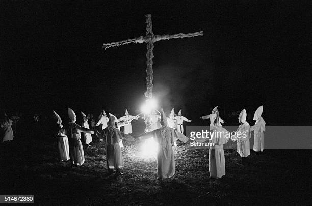A group of Ku Klux Klansmen burn a cross on a farm in Smithfield Pennsylvania