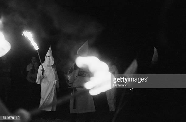 A group of Ku Klux Klansmen start burning a cross in East Windsor Connecticut