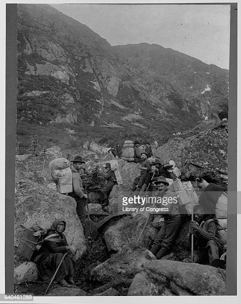 A group of ladden prospectors on a trail in the Yukon Territory during the Klondike Gold Rush 1897