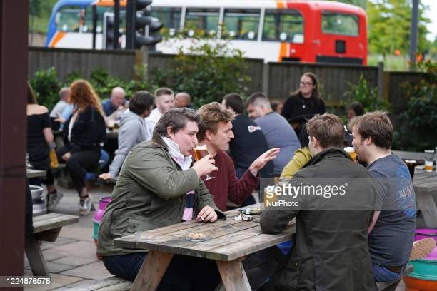 Group of lads enjoying their first pint as pub, bars and hairdressers reopened for the first time since March on 5 July in Sheffield, UK.