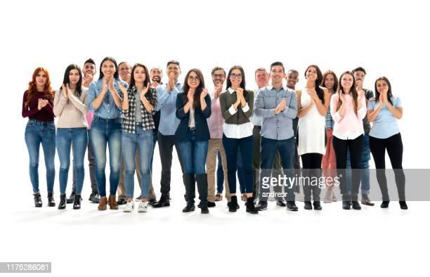スタジオでラテンアメリカの人々のグループは拍手 - 拍手喝采 ストックフォトと画像