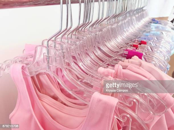 Group of leotards hanging for sale in store