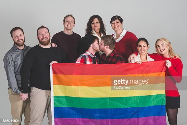 group of lgbt advocates holding pride flag - intersex photos et images de collection