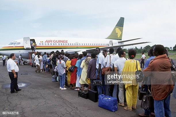A group of Liberians descended from the freed American slaves who settled in Liberia in the 1800s board an Air Guinee aircraft They are escaping the...