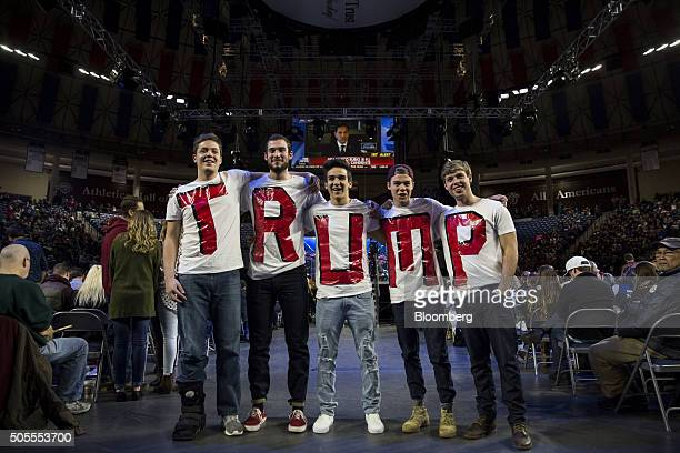 A group of Liberty University students wears tshirts spelling Trump while waiting for the start of an event with Donald Trump president and chief...
