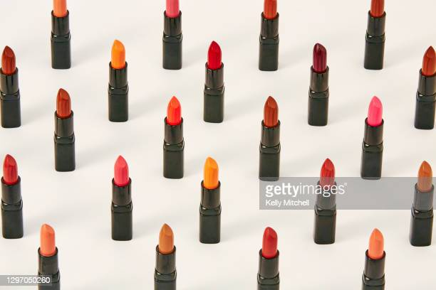 group of lipstick make up standing arranged in a grid - pink lipstick stock pictures, royalty-free photos & images