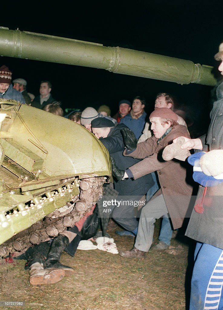 A group of Lithuanians attempt to stop a : News Photo