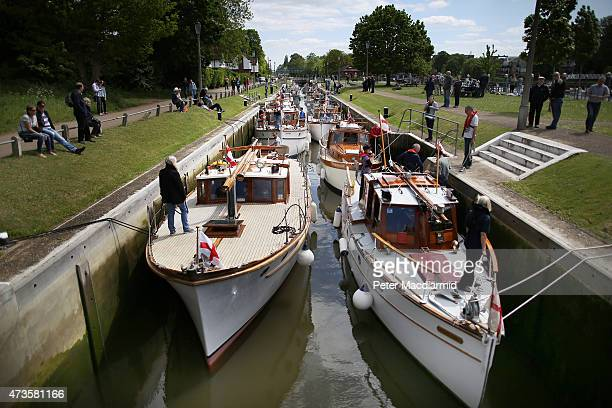 A group of 'Little Ships' waits in Teddington Lock on the River Thames on May 16 2015 in London England Every five years a reenactment of Operation...