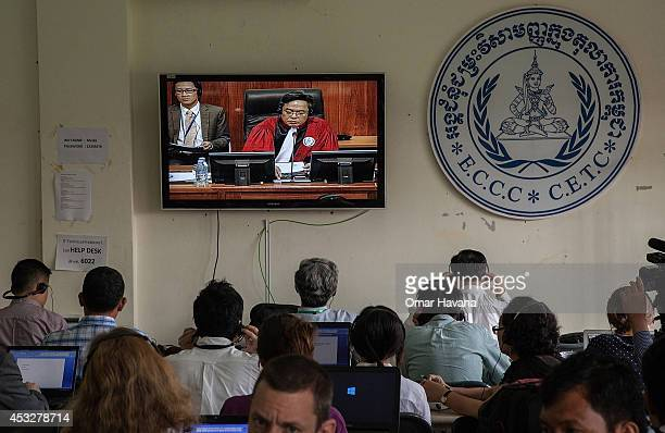A group of local and foreign journalists follow the pronouncement of the verdict for former Khmer Rouge leaders Nuon Chea and Khieu Samphan in the...