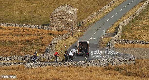 A group of local cyclists cycle along the Buttertubs Pass in Hawes North Yorkshire on March 27 2014 The climb to the Buttertubs will be tackled on...