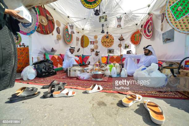 A group of local men enjoys a traditional food and coffee in side a tent in Ras Al Khaimah On Wednesday 1st February in Ras Al Khaimah UAE