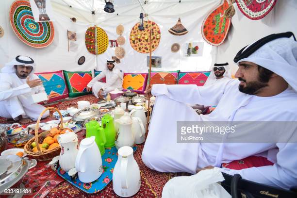 A group of local men enjoys a traditional food and coffee inside a tent in Ras Al Khaimah On Wednesday 1st February in Ras Al Khaimah UAE