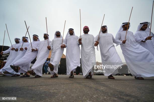 A group of local men perform the 'stick dance' a traditional fascinating UAE folk dance at the finish line of the fifth and final stage of the 2018...