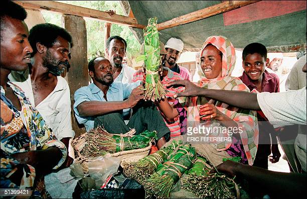 A group of local residents are eager to buy bunches of khat in the steets of Mogadishu 07 December 1992 to chew it