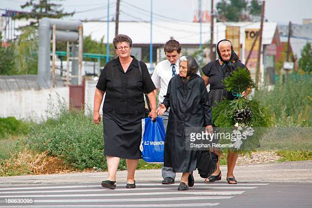 "Group of locals on their way to the cemetery ""Cimitirul Pomenirea"" in the Romanian city of Arad."