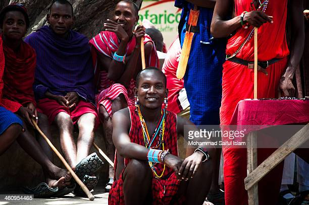 Group of Maasais were relaxing in a Market Place in Lamu Island in Kenya. When I asked them to pose for me they happily did that. This photo was...