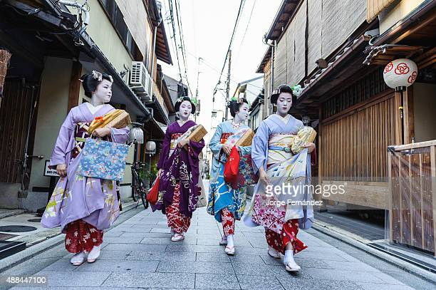 Group of maiko women going to work in Kyoto Japan