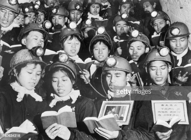 A group of male and female coal miners recite 06 September 1968 in Li Se Yuan mine some paragraphs of Mao Zedong Little Red Book as they celebrate...