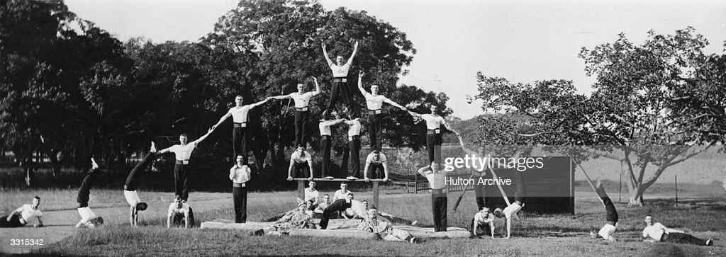 A group of male gymnasts form a human pyramid  News Photo - Getty Images