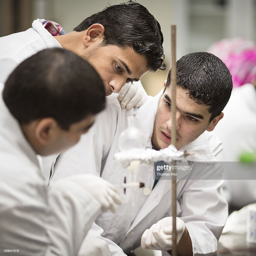 A group of male pharmacology students pictured conducting an experiment in a laboratory at the Al-Azhar University on November 06, 2013 in Gaza City, The Palestinian Territories.