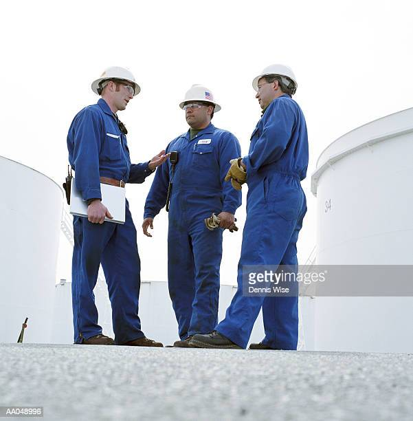 Group of male workers at oil refinery