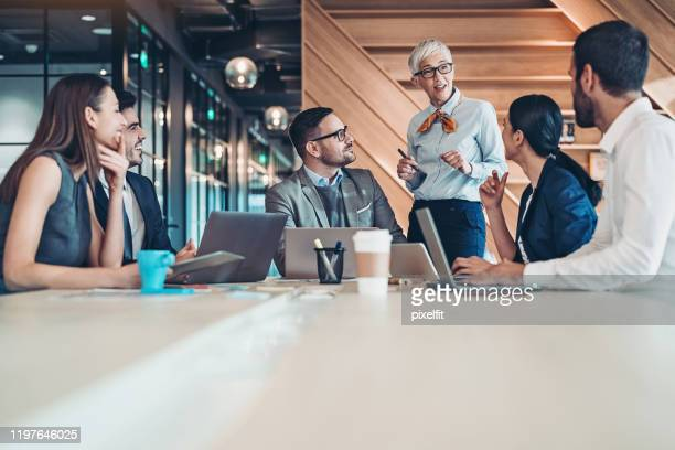 group of managers on a meeting - executive director stock pictures, royalty-free photos & images