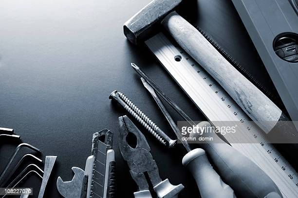 Group of many different construction tools, blue toned, copy space