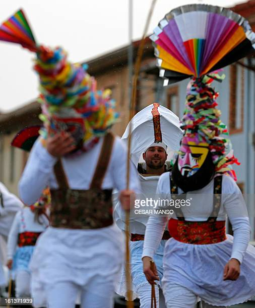 A group of masked men Antruejos parade during the carnival of Velilla de la Reina in the northern Spanish province of Leon on February 10 2013 AFP...