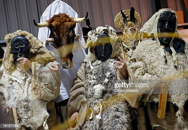 A group of masked men Antruejos wait during the carnival of Velilla de la Reina in the northern Spanish province of Leon on February 10 2013 AFP...