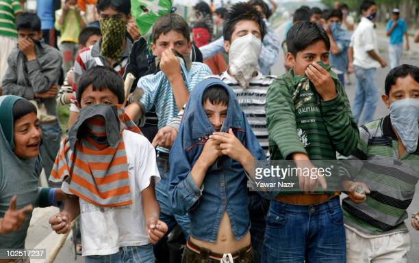 A group of masked young Kashmiri protesters shout 'Go India go' during protests on June 29 2010 in Srinagar India Three more civilans including two...