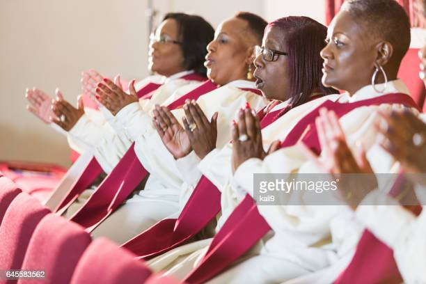 group of mature black women in church robes - gospel stock photos and pictures