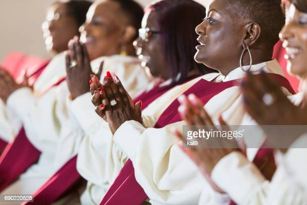 group of mature black women in church robes - church stock pictures, royalty-free photos & images