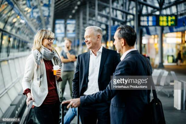 group of mature business people meeting at the airport - travel stock-fotos und bilder