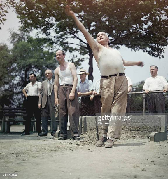 A group of mature men throwing horseshoes in Central Park in the summer of 1947