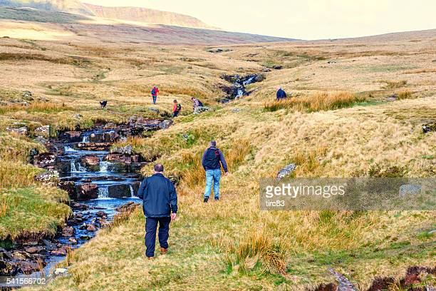 Group of mature people hiking in Welsh countryside