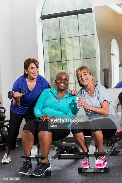 Group of mature women at the gym taking a break