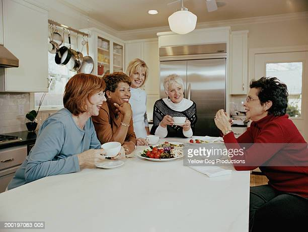 Group of mature women in kitchen